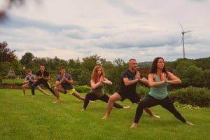 retreat doing yoga in garden