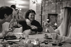 black and white photo of three women having a meal